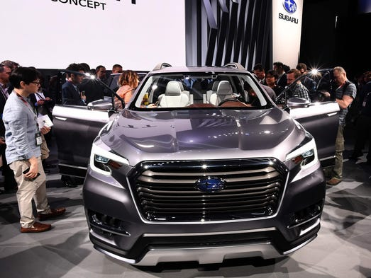 Reporters look over the Subaru Ascent SUV concept car,