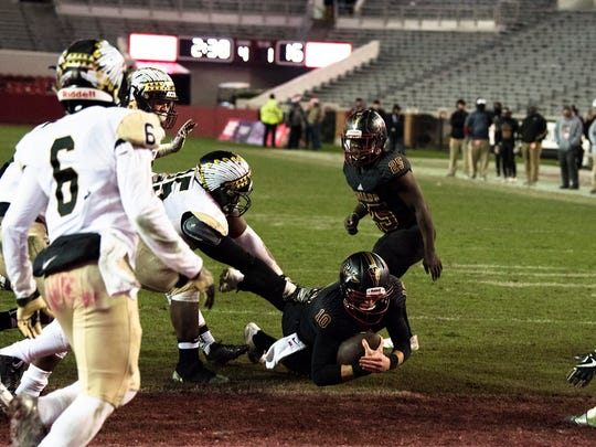 Pinson Valley's Bo Nix scores as Wetumpka's Kamyron Jackson attempts to tackle him during the AHSAA Class 6A Football State Championship on Friday, Dec. 8, 2017, in Tuscaloosa, Ala.