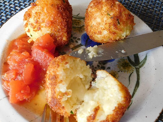 Arancini, or fried rice balls, served with tomato salsa.