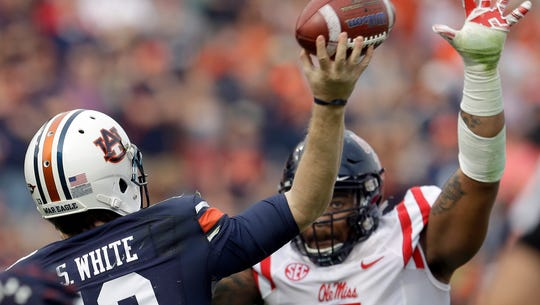 Ole Miss defensive tackle Robert Nkemdiche goes after