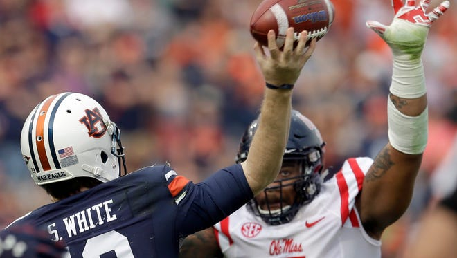 Ole Miss defensive tackle Robert Nkemdiche goes after Auburn QB Sean White's pass on this play. Before that he nearly pushed a guard into White.