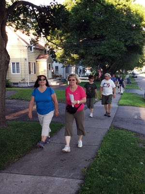 Chris Coccia, left, and Pauline Motkowski lead the group.