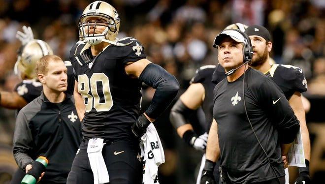 Dec 21, 2014; New Orleans, LA, USA; New Orleans Saints head coach Sean Payton (R) and tight end Jimmy Graham (80) watch a replay on a fumble during the second half against the Atlanta Falcons at the Mercedes-Benz Superdome.