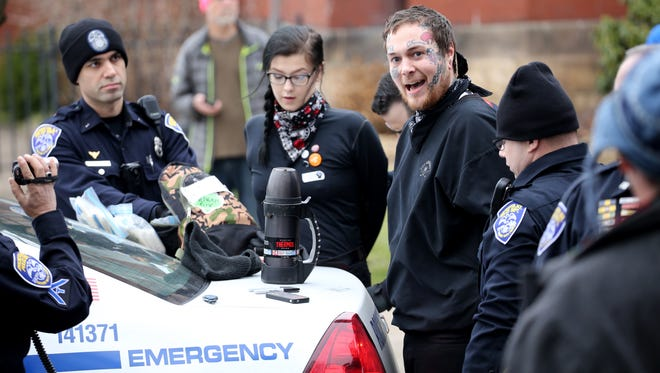 Samantha Sverski, 25, and Cory Smith, 30, were among the masked anti-fascists arrested at the People's Solidarity Rally in Rochester on Saturday, Jan. 21, 2017, for allegedly harassing a photographer and inciting to riot.