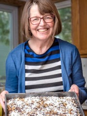"Regina Dunst still makes recipes from a cookbook of her mother's recipes, ""Recipes You Can Make Blindfolded,"" including this chocolate chip date cake."