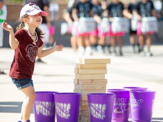 Elena Marquez, 3, claps as members of the Oñate High School marching band go by on Saturday, August 4, 2018, during the Kids EXPO 2018 hosted by the Parks and Recreation Department