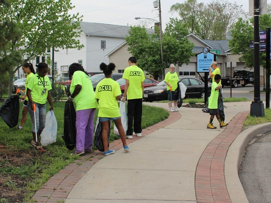 Volunteers clean up the corner of Front Street in Hammonton.