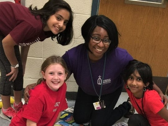 Group Leader Miss Tiara is surrounded by her students