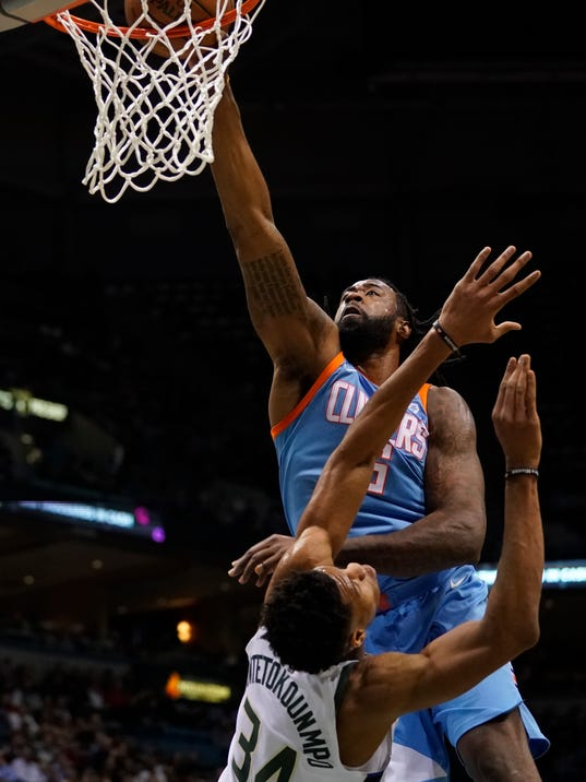 LA Clippers' DeAndre Jordan dunks over Milwaukee Bucks' Giannis Antetokounmpo during the first half of an NBA basketball game Wednesday, March 21, 2018, in Milwaukee. (AP Photo/Morry Gash)