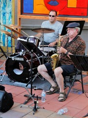 Drummer Teun Fetz, left, and saxophone player Mark Smith make up part of the host band during the weekly jazz jam session July 11 at the Studio 116 pocket park.