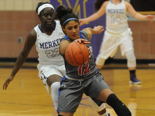Cooper's Oshianna Kerr, front, chases down a loose ball while Merkel's Ne'shemia White defends. The Lady Badgers won the nondistrict game 37-33 Tuesday, Dec. 13, 2016 in Merkel.