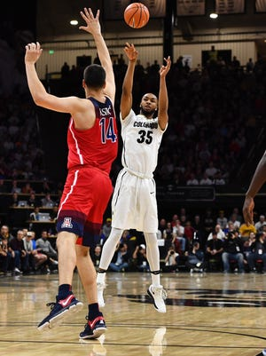 Colorado Buffaloes forward Dallas Walton (35) attempts a successful three point basket over Arizona Wildcats center Dusan Ristic (14) in the first half at the Coors Events Center.