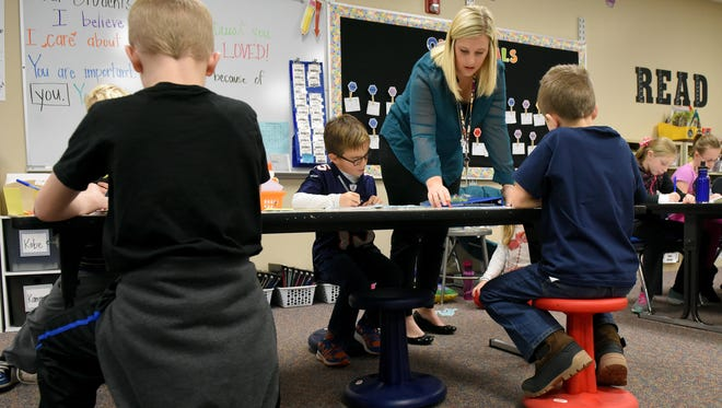 Kelly Allen (right) helps student Logan Boyle during an English lesson at Harvey Dunn Elementary School recently. Allen allows her students flexible seating in her classroom.