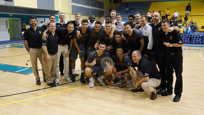 UVM poses with the championship hardware from the inaugural Islands of the Bahamas Showcase.