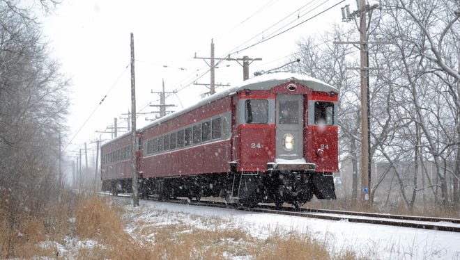 """The East Troy Electric Railroad's Christmas Train runs from the depot to """"Santa's Workshop"""" at the Elegant Farmer."""