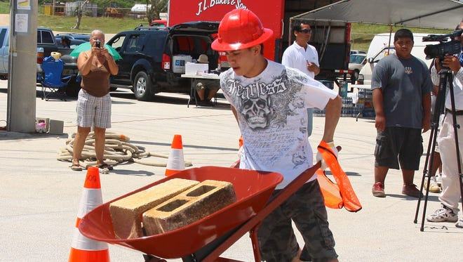 In this 2009 file photo, Jamie Taitingfong competes at a Guam Contractors Association Construction Rodeo.