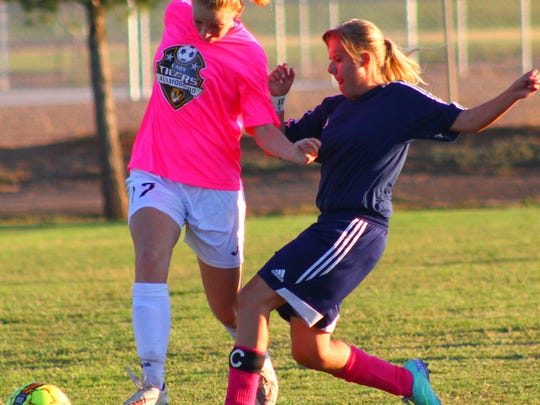 Alamogordo's Kristin Guin, left, tries to get past Deming's Tayler Rinehart on Tuesday evening.
