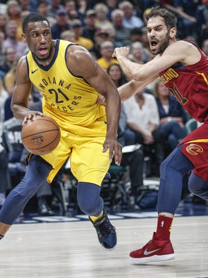 Indiana Pacers forward Thaddeus Young (21) drives to the rim against Cleveland Cavaliers guard Jose Calderon (81) during the first half of Game 4 at Bankers Life Fieldhouse on Sunday, April 22, 2018.
