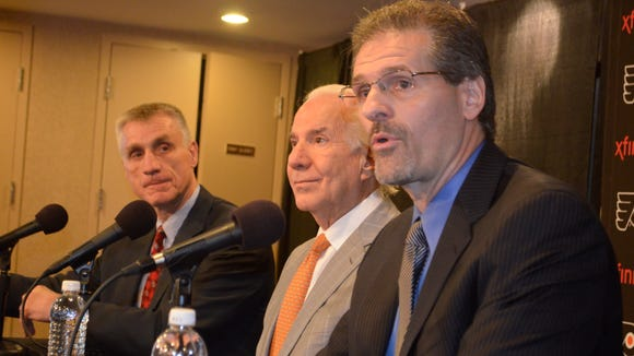 Ron Hextall, right, lays out his plan as chairman Ed Snider, center, and team president Paul Holmgren, left, look on.