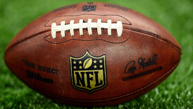 A detailed view of an NFL football.
