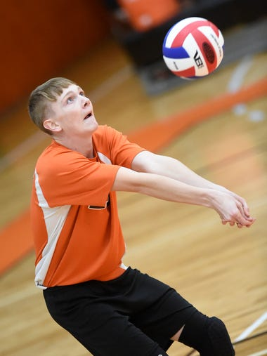 Palmyra's Tyler Sheaffer (27) bumps the ball to a waiting