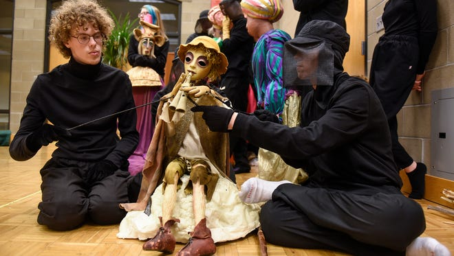 """Students control the puppet of lead character Amahl at the start of a rehearsal of """"Amahl and the Night Visitors"""" Monday, Nov. 7, at St. John's Preparatory School in Collegeville."""
