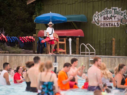 A lifeguard watches over at a giant swim lesson held