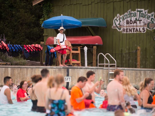A lifeguard watches over at a giant swim lesson held by Dollywood's Splash Country in its wave pool at its annual water safety day Thursday, June 21, 2018.