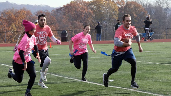 Chris D'Anna runs with the ball as participants play flag football at the second annual Tommy McGuire Turkey Bowl at Clarkstown South High School in West Nyack, Nov. 25, 2017. It was a fundraising event for the former student who was paralyzed in a swimming pool accident.
