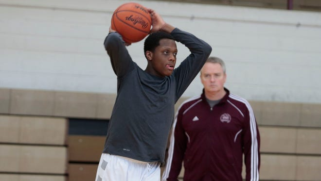 Cassius Winston looks for an open teammate at U-D Jesuit.
