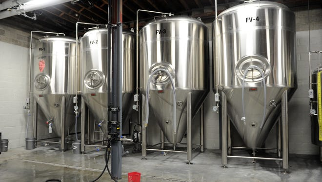 Four fermenters are displayed on at Southern Prohibition Brewery.