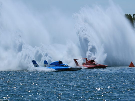 Jimmy Shane (blue) in the Miss Madison, and J. Michael Kelly (red) in the Team Porter Racing I on the Detroit River at Detroit Hydrofest on Saturday, Aug. 27, 2016.
