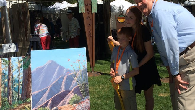 Indian Wells Mayor Dana Reed presented siblings Lauren and Aaden Kinman with Youth Artists at Work ribbons during opening day of the Indian Wells Arts Festival.