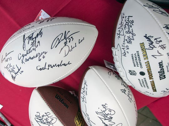 Signed footballs were a part of the 30th Annual Eddie Khayat & George Tarasovic Celebrity Golf Classic supporting York County Special Olympics.