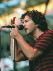 Pearl Jam's Eddie Vedder performs at a benefit concert in 1998.