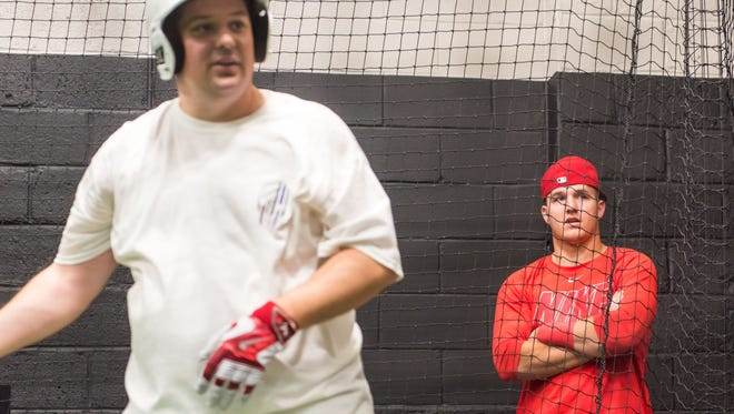 Millville native and 2016 American League MVP Mike Trout gives Patrick Carey, 37, batting practice tips at Phenom Baseball Academy in Millville on Wednesday, December 14.