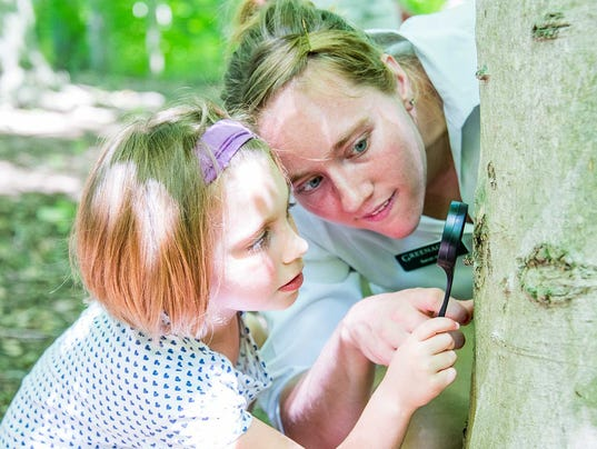 636379701295453910-G.Sarah-and-kid-with-magnifying-glass---Low-Res.jpg