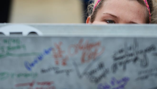 Cailyn Grames signs the final metal beam to be placed in the new Riverside Shore Memorial Hospital building being constructed in Onley, Va. on Friday, Jan. 15, 2016. The hospital held a beam signing ceremony before it was placed in the building.