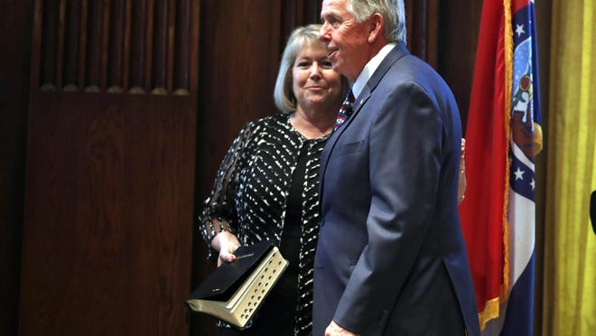 Gov. Mike Parson, right, smiles along side his wife, Teresa, after being sworn in as governor in 2018. Teresa Parson has announced she will go ahead with an Oct. 3 public event at the Governor's Mansion taking place a few days after her isolation period for COVID-19 will end.