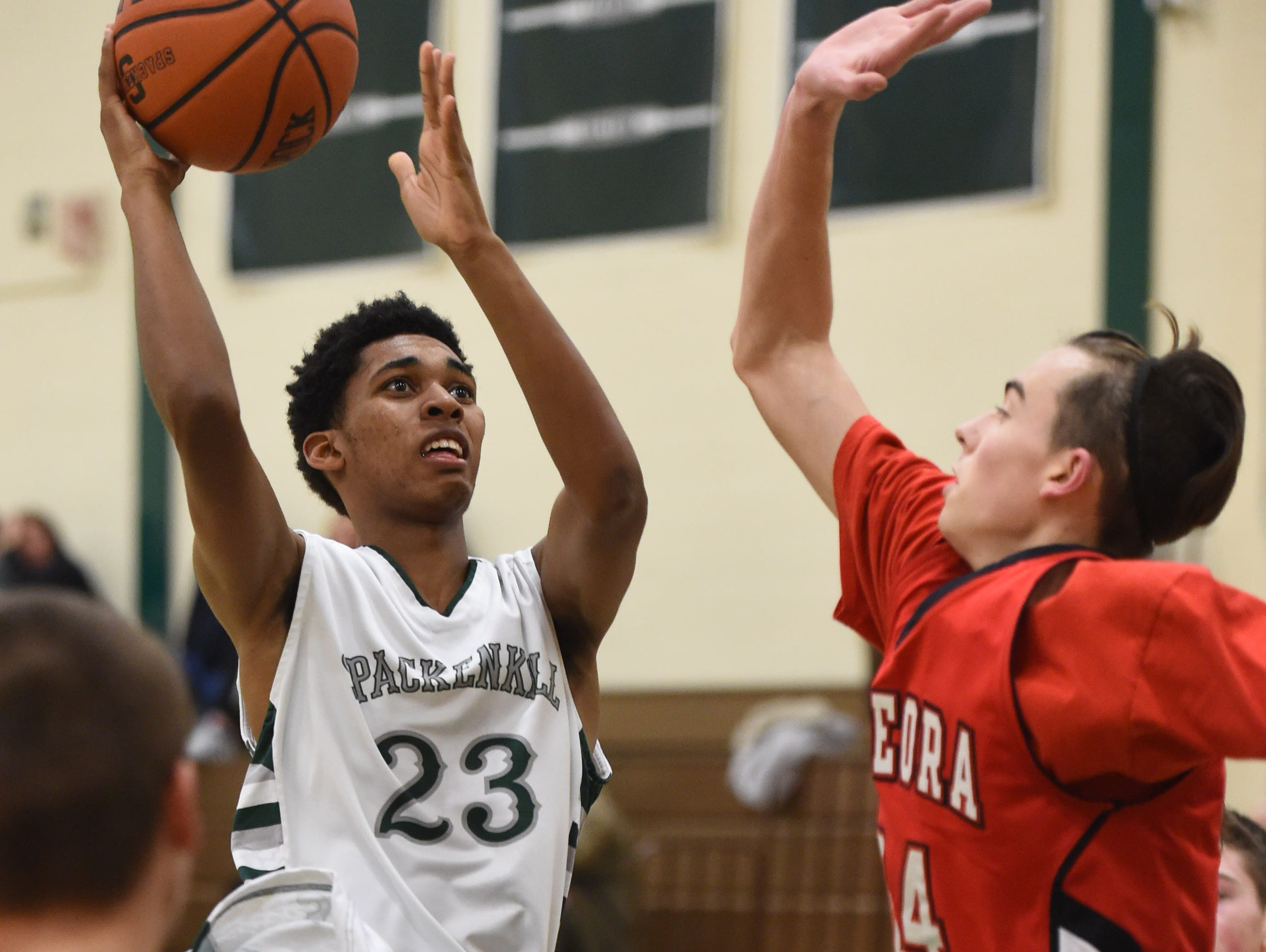 Spackenkill's Stanley Garrant takes a shot as Onteora's Miles Eberhard covers him during Thursday's game at Spackenkill.