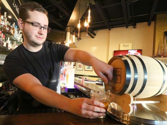 Bar manager Adam Nobs adds Bulleit Rye aged in a bourbon cask to Pewaukee's Artisan 179 version of the classic Old-Fashioned, Ron and Mary's Brown Mumbler.