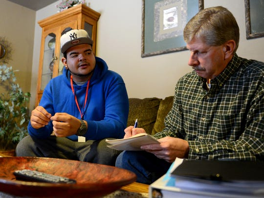 Mentor Terry Roberts meets with Felix Louis Rivera Medina at his foster home in Green Bay, to discuss education, job opportunities, and housing on Dec. 4. Louis is preparing to age out of the foster system.