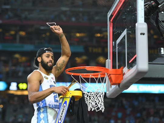 North Carolina guard Joel Berry II cuts down the net