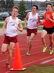 Milford's Luke Sakkinen (left) and teammate Dakota Giles (middle) turn the corner in the 800-meter run.