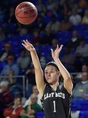 Riley Hurst (1) shoots as East plays Upperman in Division