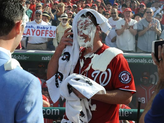 Sept. 28: Nationals' Jordan Zimmermann reacts after taking a shaving cream pie to the face after throwing a no-hitter against the Marlins.