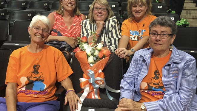 """Save Lady Vols"" supporters, clockwise from left, Susan Whitlow, Mollie DeLozier, Raubyn Branton, Donna Branton and Jean Lusardi pose for a photo with a ceremonial chair at Pat Summitt's memorial service in July 2016."