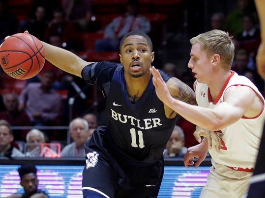 Butler guard Kethan Savage (11) drives around Utah guard Parker Van Dyke, right, in the first half during an NCAA college basketball game Monday, Nov. 28, 2016, in Salt Lake City. (AP Photo/Rick Bowmer)