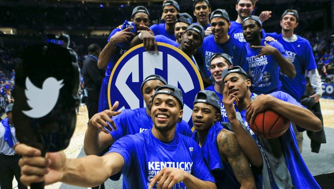 Kentucky's Isaiah Briscoe takes a photo of him and his teammates after the Wildcats beat Texas A&M 82-77 in overtime in the SEC Tournament Championship game Sunday at Bridgestone Arena.