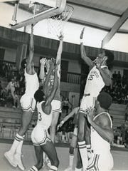 Surrounding an Oakcrest player for Lakewood during a 1975 state tournament game are (left-to-right) Robert Long, Kelvin Troy, Kevin King and Myron Crippen.